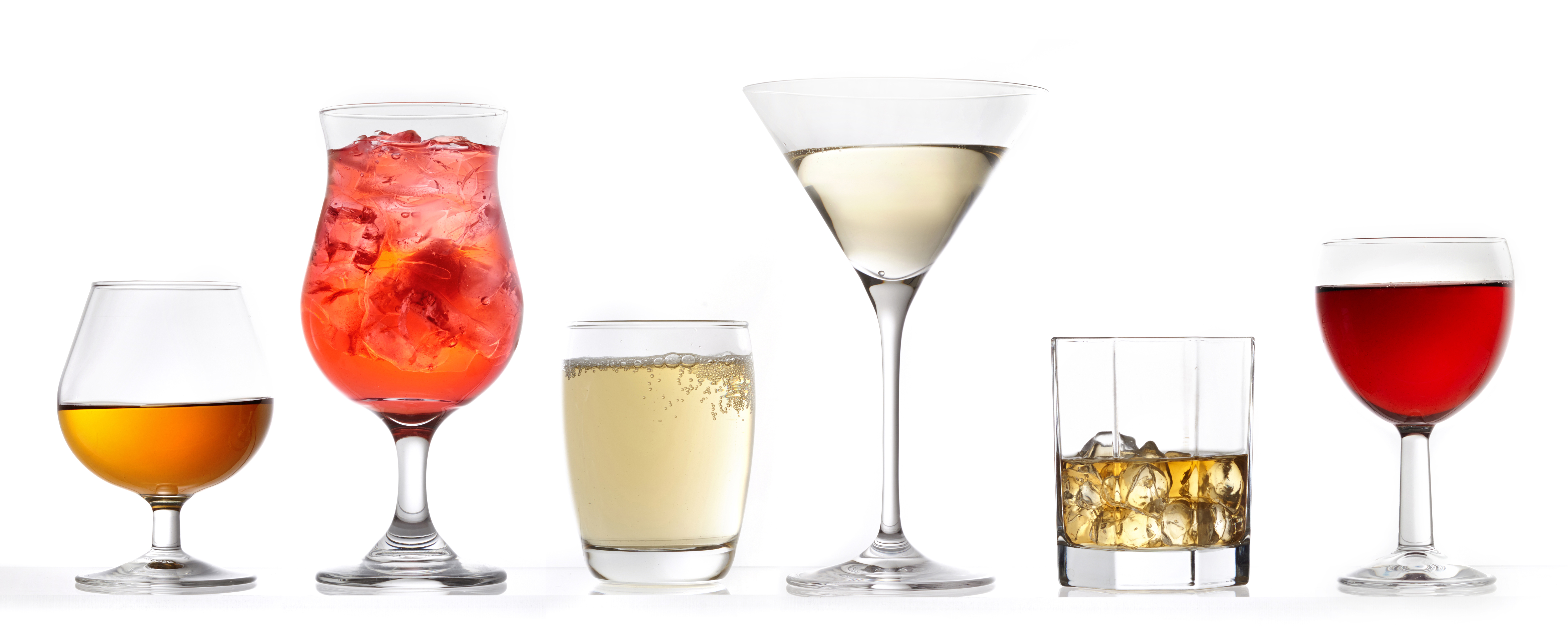 three glasses of various drinks on a white background